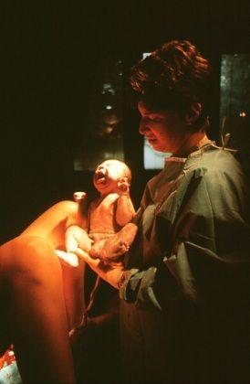 m8100190-natural_childbirth_doctor_holds_newborn_baby_boy.630x420
